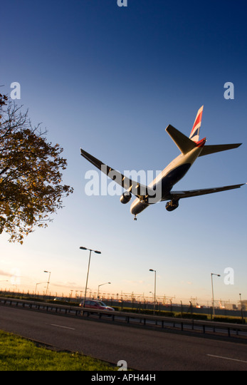 British Airways Boeing 777-236ER coming to land on runway 27L at London Heathrow Airport UK - Stock Image