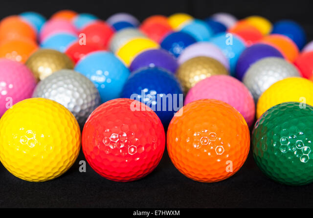 Assortment of colorful mini golf balls on black - Stock-Bilder