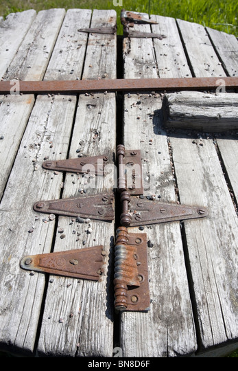 old hinges on decayed wooden lid - Stock Image