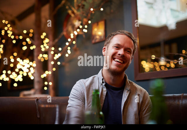 Young Man Relaxing Inside Cafe - Stock Image