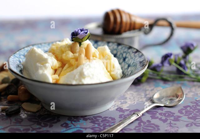 Greek yoghurt with honey and pine nuts - Stock-Bilder