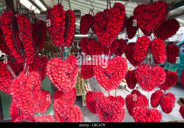 Germany, Bavaria, Munich, Viktualienmarkt, Heart Shaped Floral Display - Stock-Bilder