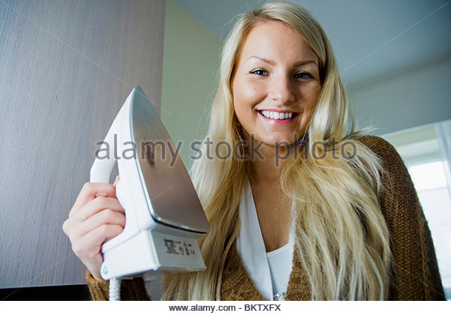 Girl with iron - Stock Image