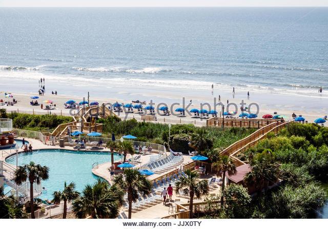 South Carolina SC Atlantic Ocean Myrtle Beach Wyndham SeaWatch Plantation hotel resort sand pool - Stock Image