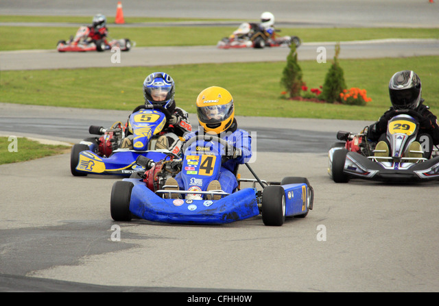 Children competing in a go kart race - Stock Image