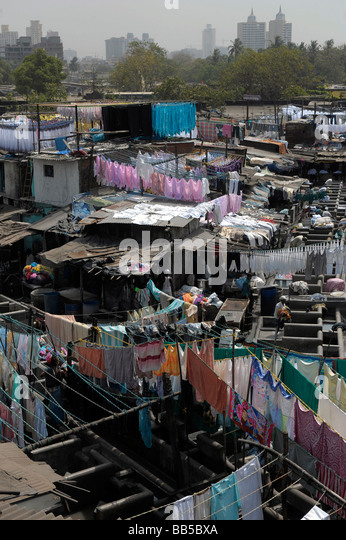 View of Dhobi Ghats with Mumbai skyline in the background - Stock Image