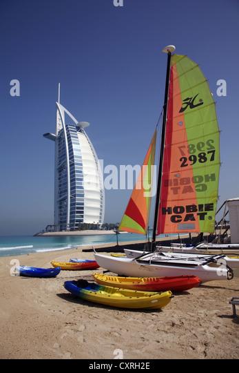 Sailboat sailing beach beaches stock photos sailboat for Sailboat hotel dubai