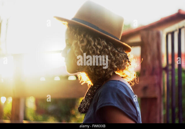 Side View Of Woman Wearing Hat - Stock Image