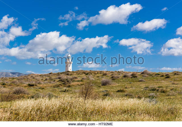 View of Brown Grass Field and Paphos Lighthouse at Paphos Archaeological Park, Paphos, Cyprus - Stock Image