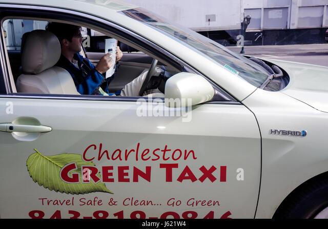Charleston South Carolina transportation Green Taxi hybrid car vehicle fuel economy lower emission conservation - Stock Image
