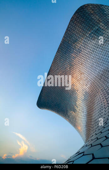 Sunset reflects off the modern Soumaya Museum of Art in Mexico City, Mexico. - Stock Image