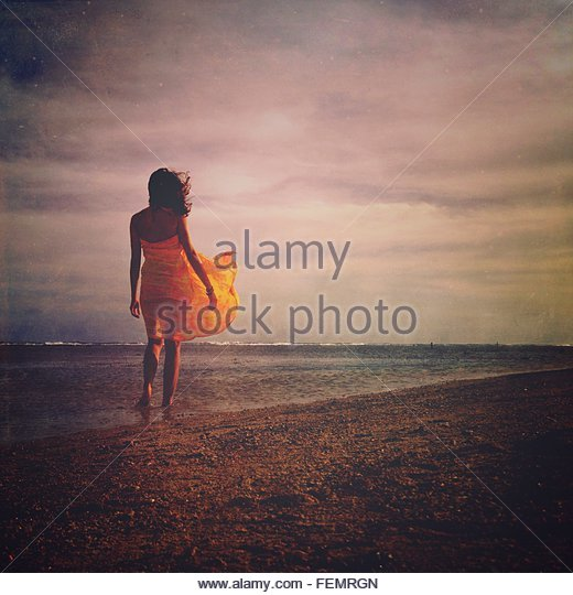 Woman Standing On Beach - Stock Image