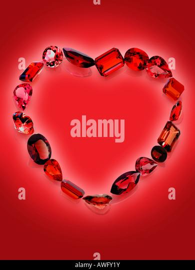 red gemstones hearth shaped - Stock-Bilder