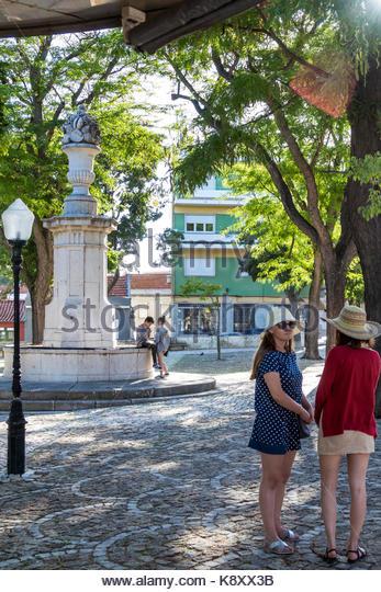 Portugal Lisbon Belem Largo Princesa plaza fountain urban park woman young adult hat Hispanic teen girl friends - Stock Image