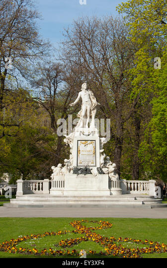 Mozart  Statue, Vienna, Austria in the Burggarten gardens. Musical note in flowers - Stock Image