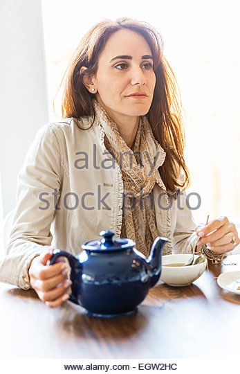 Woman having tea. - Stock-Bilder