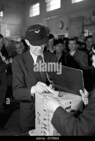 An employee of the East German State Railway during the ballot vote about the continuation of the strike stands - Stock Image