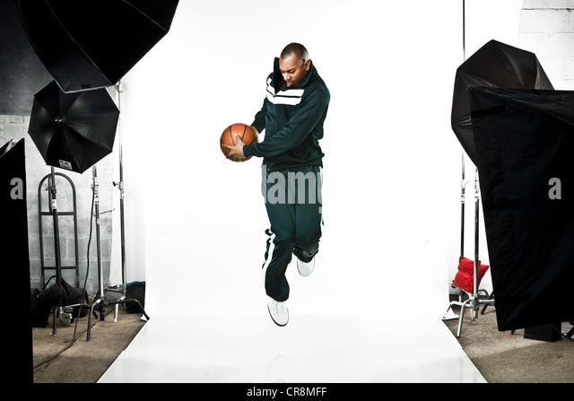 Basketball player at photo shoot - Stock Image