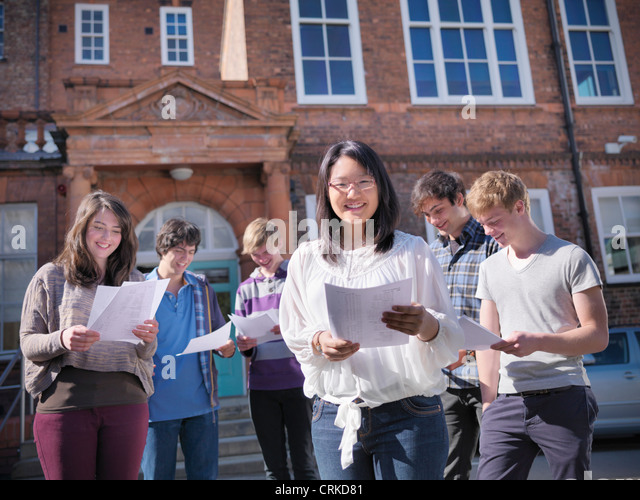 Students reading grades together - Stock Image