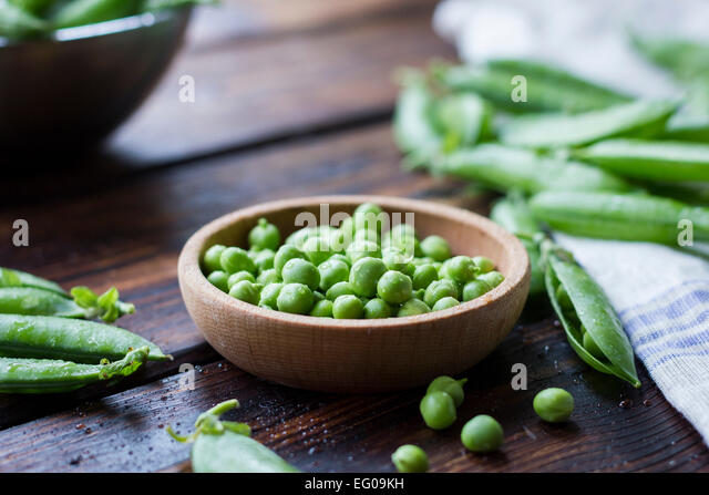 Peas in a bowl - Stock Image