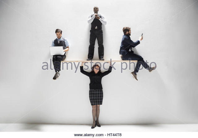 Businesswoman balancing businessmen overhead against white background - Stock-Bilder