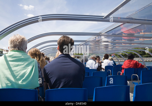 Copenhagen Denmark EU Visitors on covered canal tour cruise boat - Stock Image