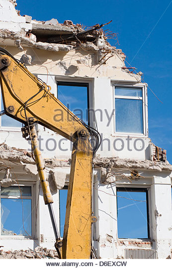 Demolition site digger building destruction old - Stock Image