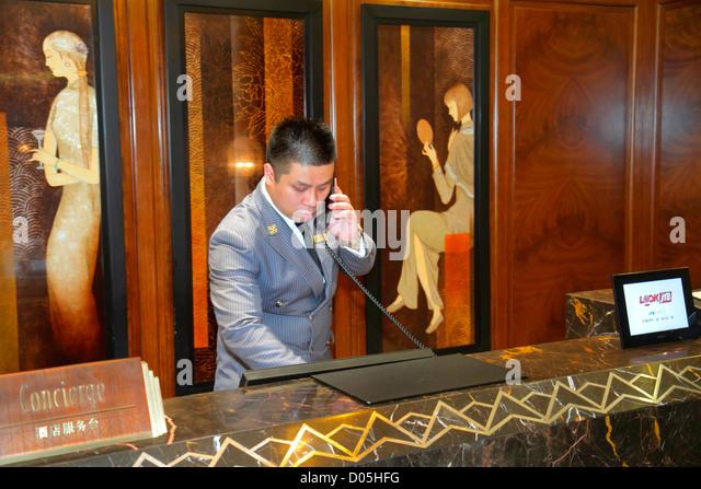 Shanghai China Huangpu District The Bund Zhongshan Road National Day Golden Week Asian man desk concierge Fairmont - Stock Image