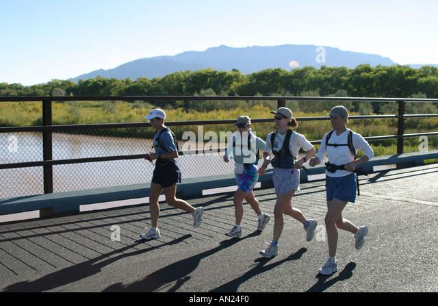 New Mexico Albuquerque Rio Grande State Park joggers Sandia Mountain T - Stock Image