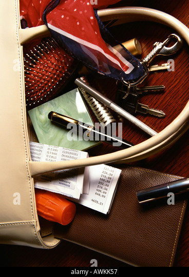 Contents of woman's purse spilling out - Stock Image