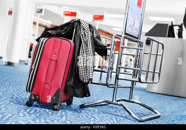 Travel suitcase at the airport - Stock-Bilder