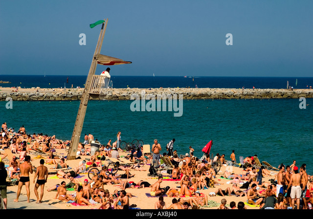 Spain Barcelona beach Platja de la Barceloneta baywatch tower people crowded beach - Stock Image
