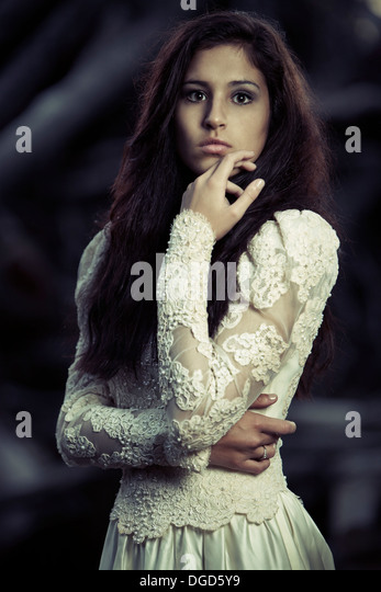 Young woman in antique wedding dress - Stock Image