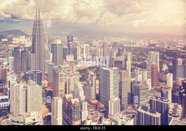 Vintage stylized photo of Kuala Lumpur skyline, Malaysia. - Stock Image