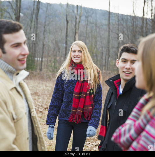 A group of four people outdoors on a winter day. - Stock Image