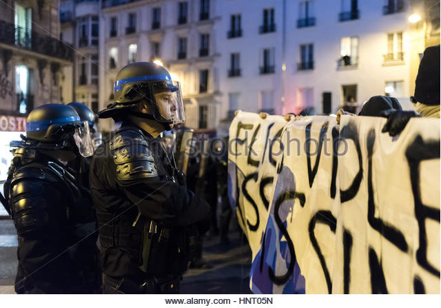 Paris, France. 15th Feb, 2017. Riot police officers face protesters as people gather during a demonstration to show - Stock Image