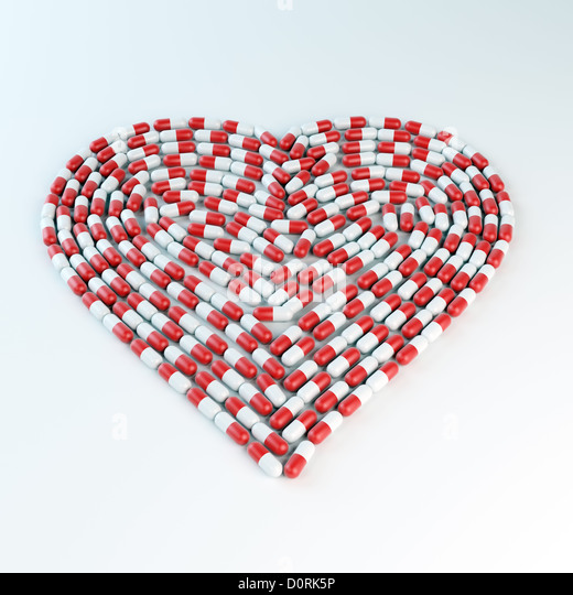 Red and white capsules forming a heart shap - Stock-Bilder