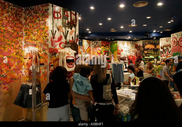 spain Barcelona Port Vell Rambla de Mar Maremagnum shopping center Desigual fashion design store - Stock Image