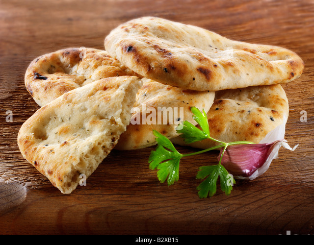 Garlic and coriander Indian Naan Bread - Stock Image