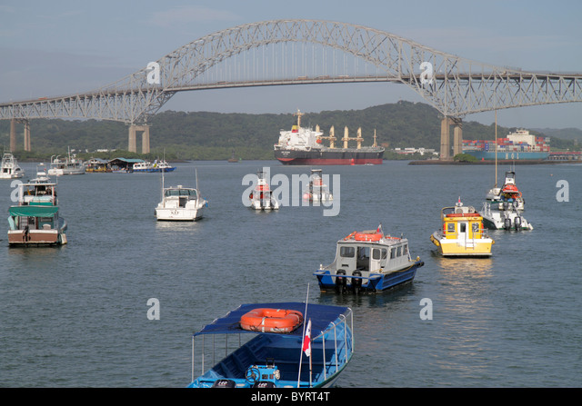 Panama City Panama Amador Panama Canal Pacific Ocean approach Puente de las Americas Thatcher Ferry Bridge boat - Stock Image