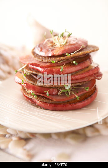 Layered buckwheat pancakes,apple and bacon - Stock Image
