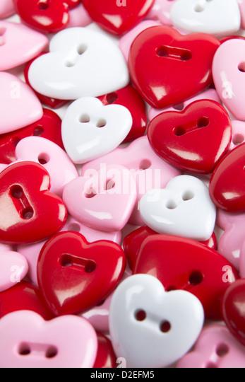 Overhead View Of Heart Shaped Buttons - Stock-Bilder