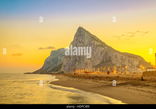 View on Gibraltar rock at sunset from beach in La Linea de la Concepcion, Andalusia, Spain - Stock Image