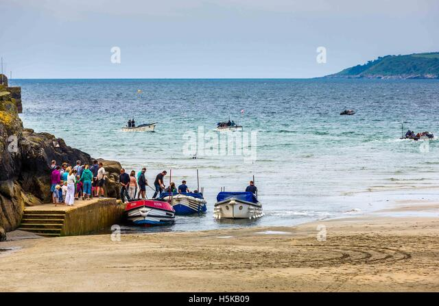 a  view of ferry boats St. Michael's Bay and sea shore in Cornwall. - Stock Image