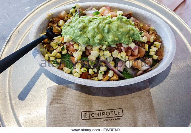 Florida FL Miami Chipotle restaurant Mexican food inside food bowl guacamole - Stock Image