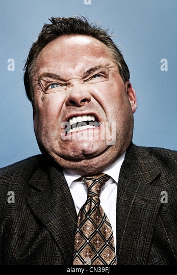 Businessman looking angry - Stock Image