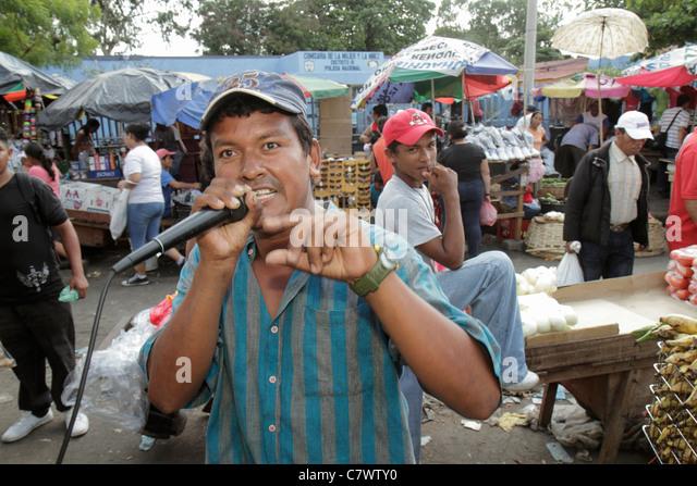 Managua Nicaragua Mercado Oriental flea market marketplace shopping vendor stall shed peddler selling promoting - Stock Image