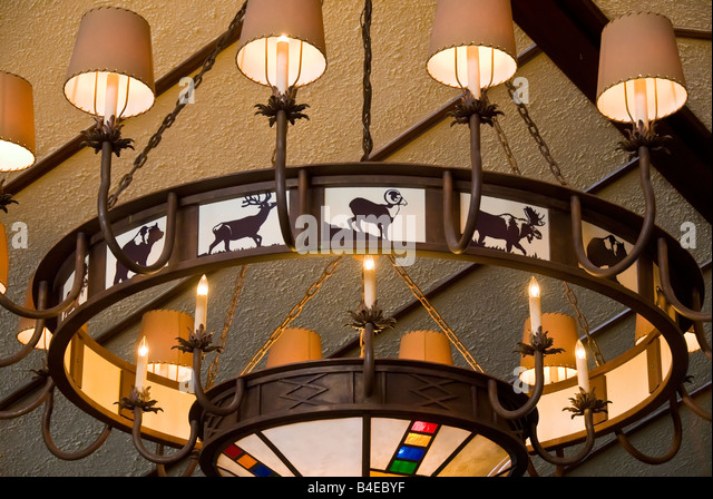 Bright chandelier with animal figures decor detail Fairmont Jasper Park Lodge, Canada - Stock Image
