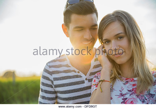 Portrait of beautiful woman with man outdoors - Stock Image