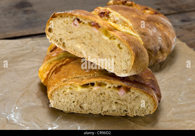 Crumb of home baked bread, Handbrot, with a filling of ham and Emmental cheese, Saxon specialty - Stock Image